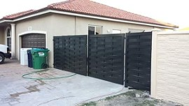 Fence - Surround your home or business with durable aluminum fences, wood fences, or chain-link fences from our company in Miami, Florida.